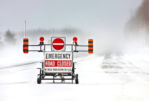 A winter road is closed to traffic.