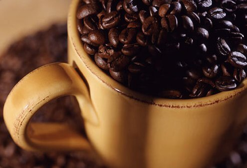 A cup full of coffee beans.