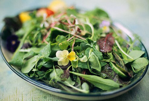 A bowl of leafy green salad.