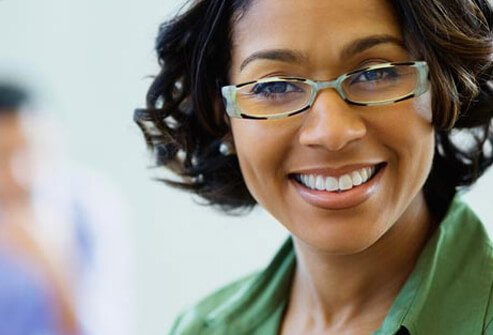 Photo of smiling woman in glasses.