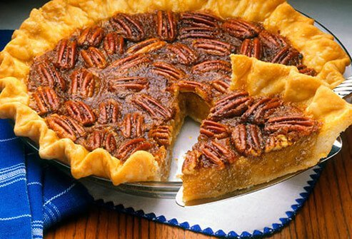 Homemade pecan pie with slice cut out