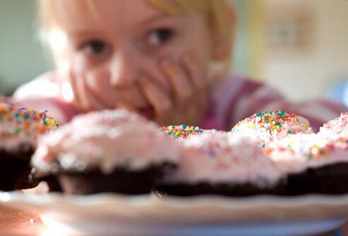 Photo of child looking at cupcakes.