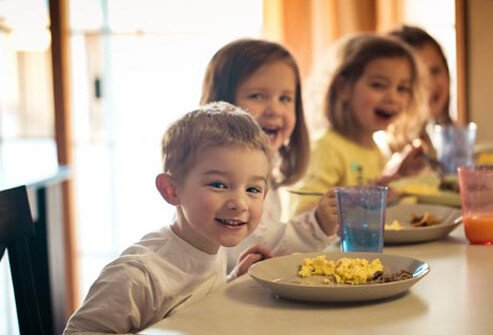 Photo of children eating breakfast.