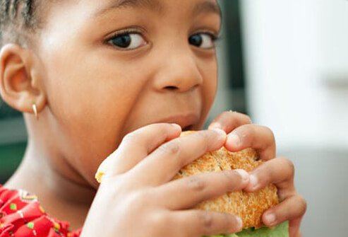Photo of child eating sandwich.