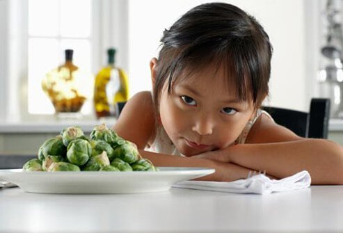 Photo of girl with brussel sprouts.