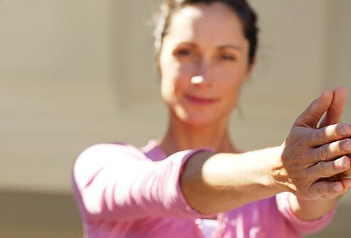 Woman doing some simple exercise routines to boost her energy.