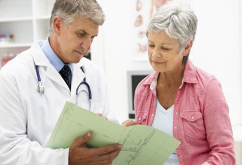 A doctor reviewing fibromyalgia treatments with a patient