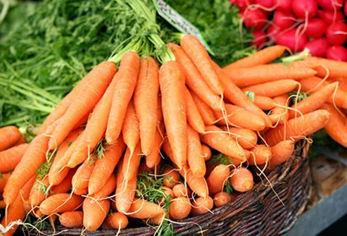 A basket of carrots at a farmers market, helping to fight depression.