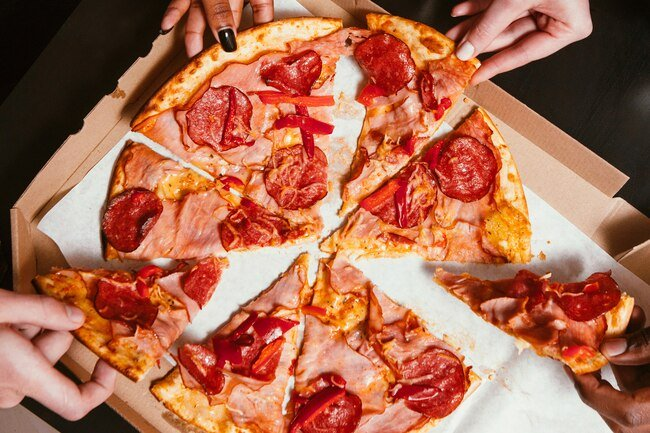 Take out pizza is typically high in fat, sodium, and excess calories, which increase the risk of a heart attack.