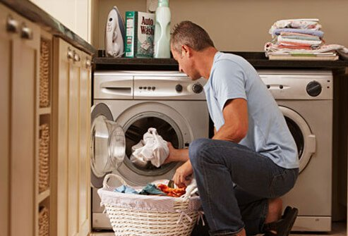 Photo of a man doing laundry.