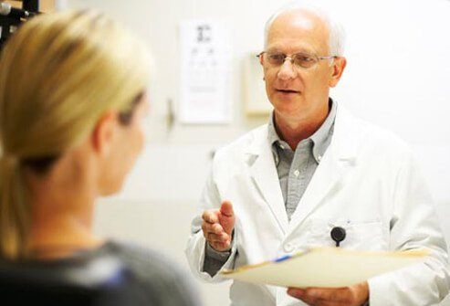 Photo of doctor talking to woman.