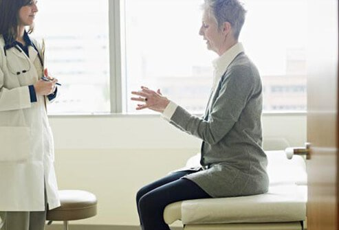 Photo of woman talking to doctor.