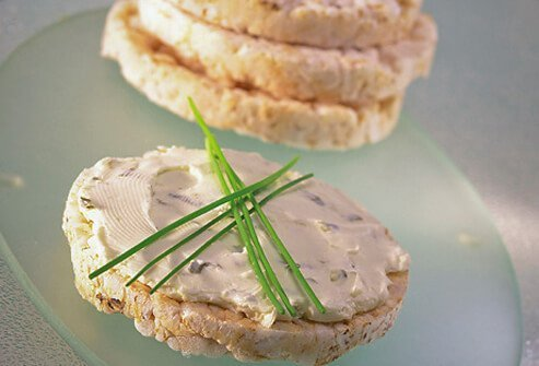 Rice cakes with spread herbs.