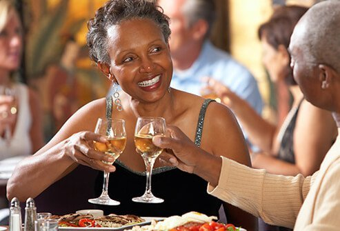 Couple celebrating with dinner and wine.
