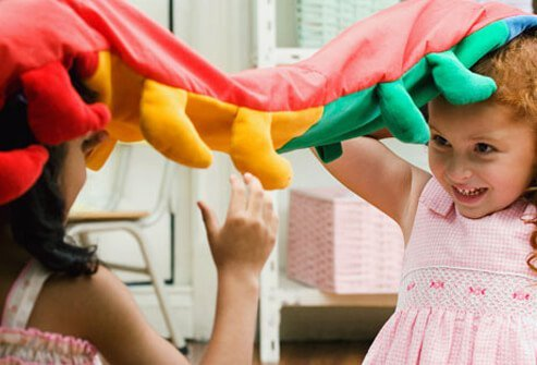 Photo of two girls playing with toys.