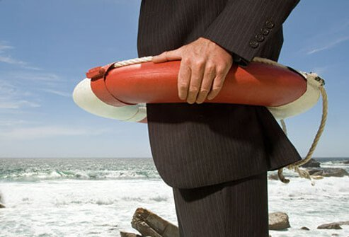 An executive wearing a life preserver.