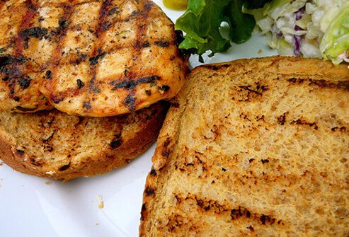Fresh grilled chicken sandwich on whole wheat bun.