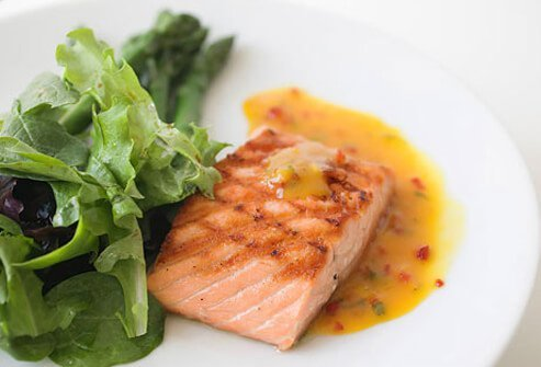 A photo of grilled salmon and salad.