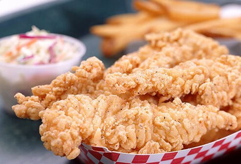 A photo of fried chicken strips.