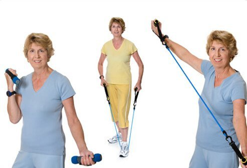 A senior woman exercises with weights and resistance bands.