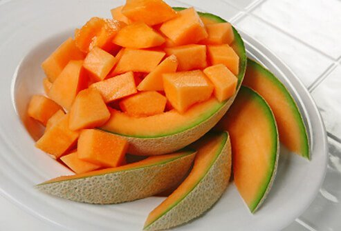Cubes and wedges of fresh cut cantaloupe.
