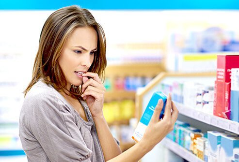 A woman shops for stool softeners to treat her hemorrhoids.