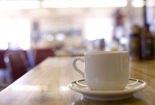 A photo of a cup of coffee on the counter, a cause of high blood pressure.