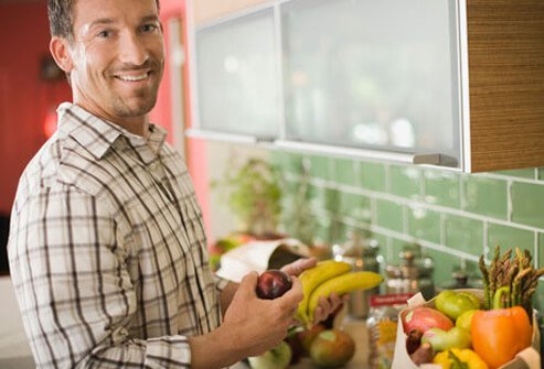 A photo of man holding fruit; DASH diet can treat high blood pressure.