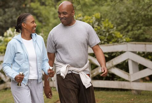 A photo of a couple walking together, lowering blood pressure.