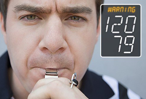 Photo of referee blowing a whistle indicating a warning for prehypertension level.
