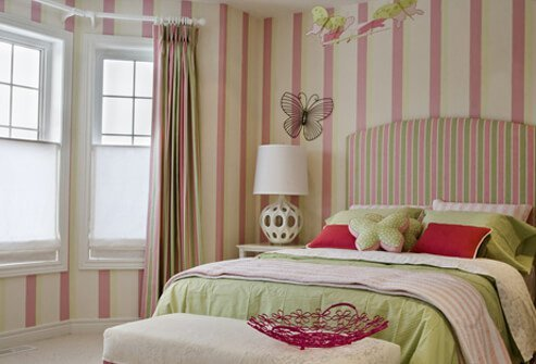 Girl's bedroom displaying shades on the windows.