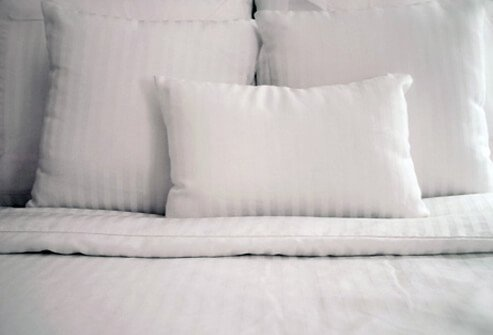 Assortment of synthetic pillows.