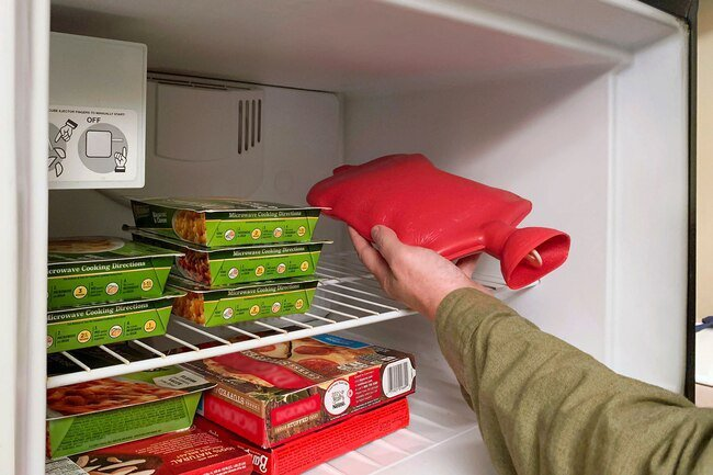 Fill a hot water bottle and put it in the freezer to keep you cool.