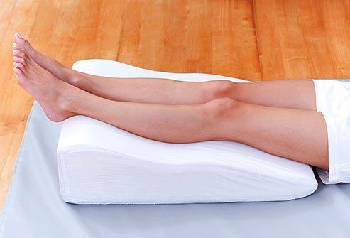 Putting a pillow or rolled-up towel under your knees can help keep the natural curve of your spine.