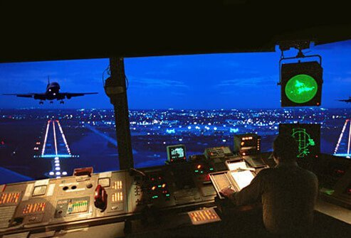 Photo of an air traffic controller at night.