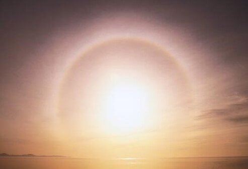 A view of a sunset with a halo effect.