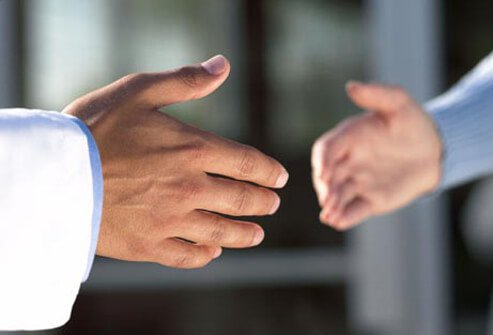 A doctor and patient giving a handshake.