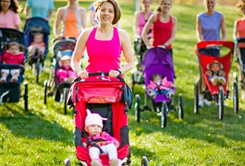 A group of mothers with their babies in strollers.