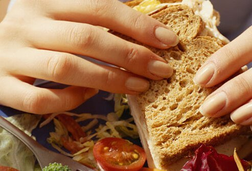 Woman eating healthy sandwich.