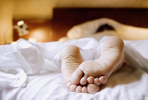Feet of a person lying in bed.
