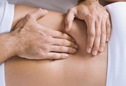 A chiropractor performs an adjustment.