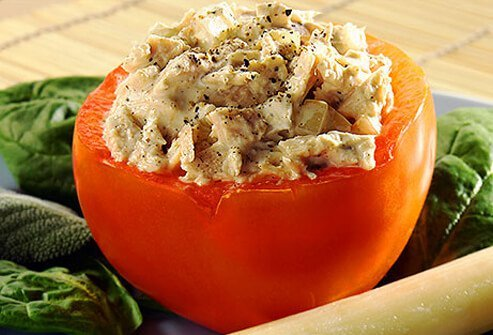 Photo of a tomato stuffed with tuna.