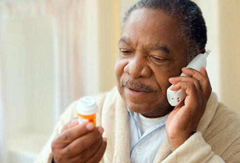 A man speaks with his doctor on the phone about his medication.