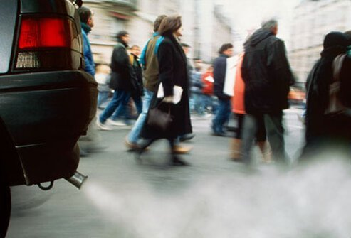 People walking through car exhaust, putting themselves at risk for lung cancer.