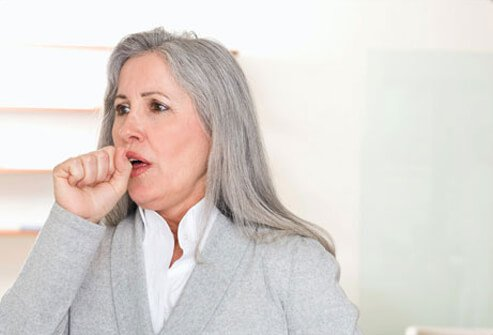 A woman with lung cancer coughing.