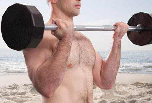 Stand gripping a barbell at thigh level.
