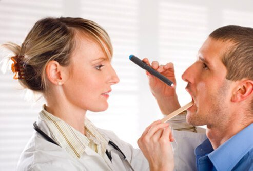 A doctor examines a patient's throat for signs of mono.