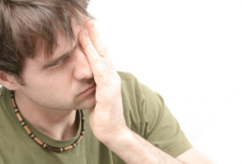 A young male is exhausted and still feeling the effects of infectious mononucleosis.
