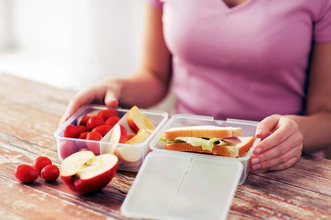 Before you leave the house for the day, grab a sack and pack a healthy lunch and low-calorie snacks like fresh fruit or low-fat cheese.
