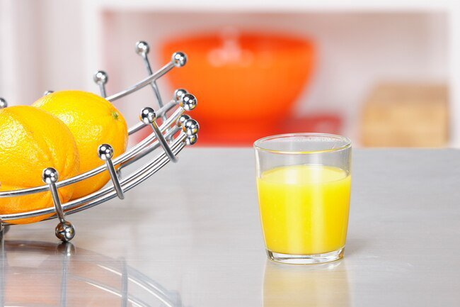Most standard drinking glasses are far larger than a serving of juice.